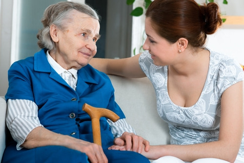 caregiver helping a senior