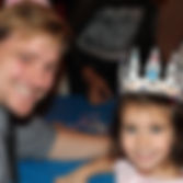 father and daughter enjoy children's activities at the Sixty-Five Roses Princess Ball Winnipeg in support of Cystic Fibrosis Canada