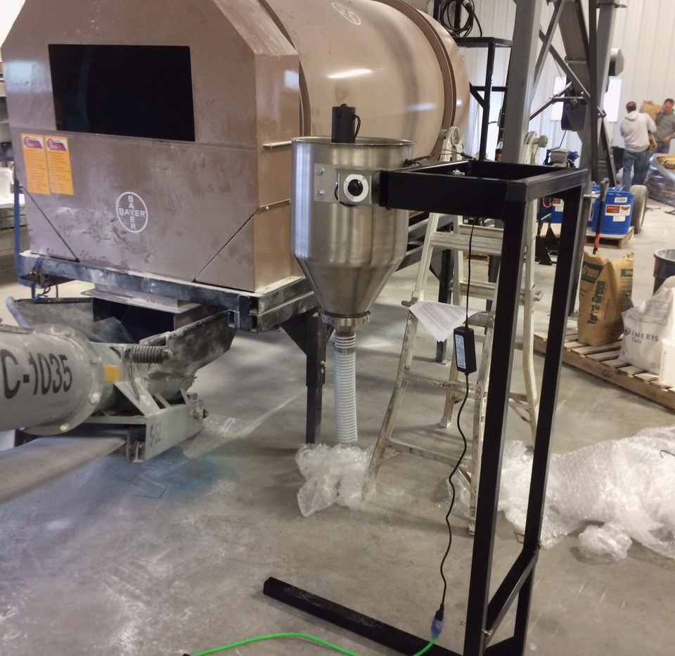 CT Standard Dry Applicator on CT Portable & Adjustable Stand being used with the Bayer On-Demand seed treater.