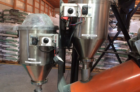 Two CT Standard Dry Applicators mounted on a conveyor for treating multiple products.