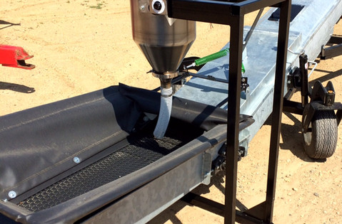 CT Standard Dry Applicator on Portable & Adjustable Stand with GrainMaster conveyor.