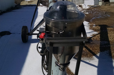 CT Standard Dry Applicator mounted on a conveyor.