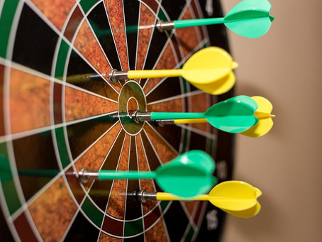 What does an ear and a dart board have in common?