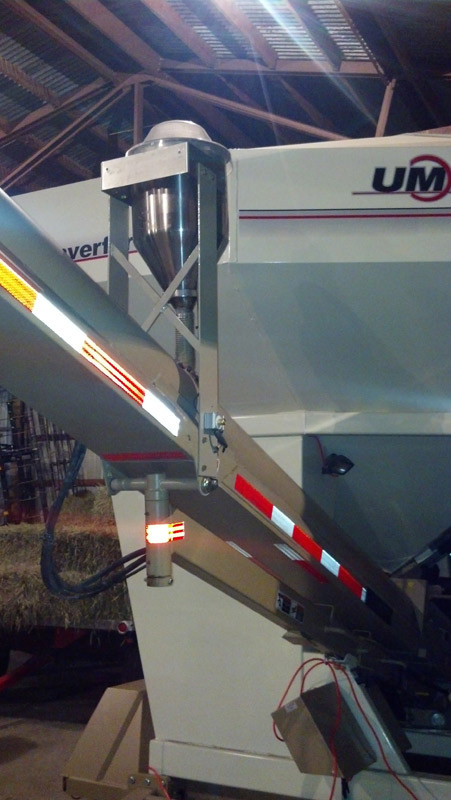 The CT Dry Powder Applicator can mount above an auger or conveyor and treats seeds just before they are planted.