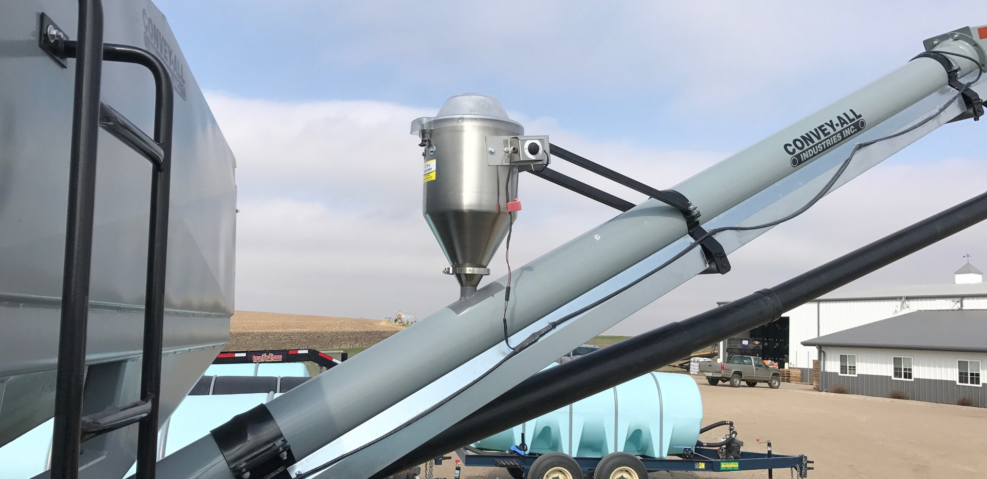 6 Gallon 12v dry applicator mounted on a Convey-All seed tender.