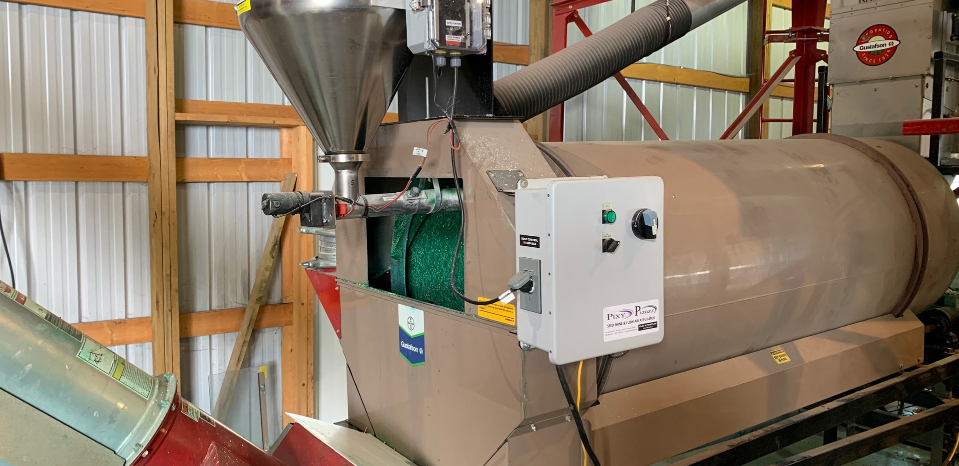 CT 14 gallon applicator, mount, auger & automated panel on a Bayer drum treater.