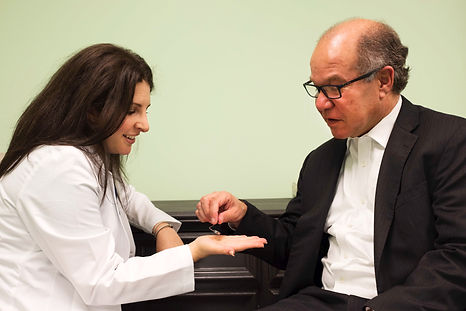Dr. Wikoff consulting in a hearing aid fitting