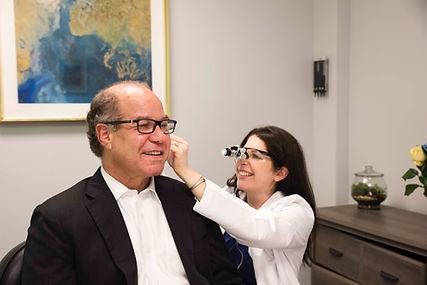Dr. Wikoff performing examination