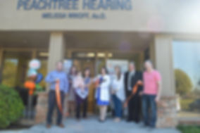 Peachtree hearing ribbon cutting