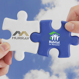 Hands-Holding-Puzel-Pieces-of-Murray-Roo