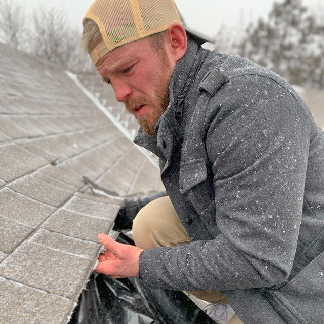 Paul Sanders of Murray Roofing Repairing Shingles in a Snow Storm