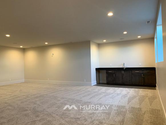 Murray Custom Home Builders Gallery SW Village Heights 6525 Basement Living2