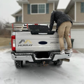 Murray Roofing Arriving at a Job in a Snow Storm