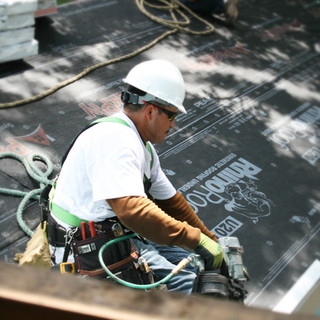 Roofers at Work Donating a Roof for Habitat for Humanity