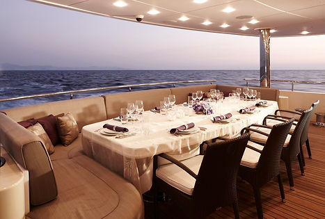 Stunning dinner table setting on a private yacht: our chefs are used to catering on water!