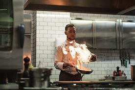 Chef flambéeing food