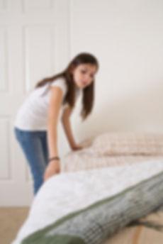 Girl making bed (1).jpg