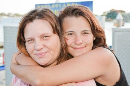 istock girl hugging mum.jpg