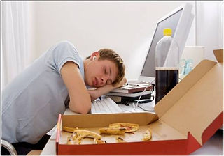Teen asleep by computer with pizza.jpg