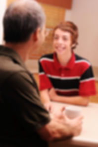 istock boy talking to man and smiling (1