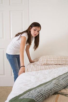 Girl making bed.jpg