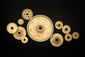 photo-of-golden-cogwheel-on-black-backgr