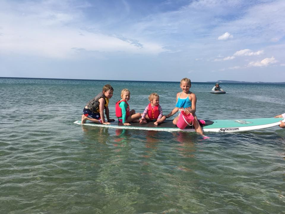 Cousins hanging out on the paddleboard.