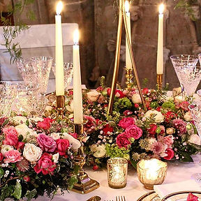 candlelit floral table centrepiece