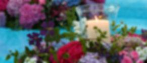 Floating candlelit arrangement with hydrangeas and lush foliage