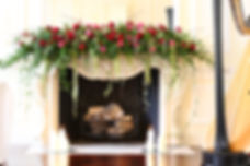 floral mantelpiece with harp and candles