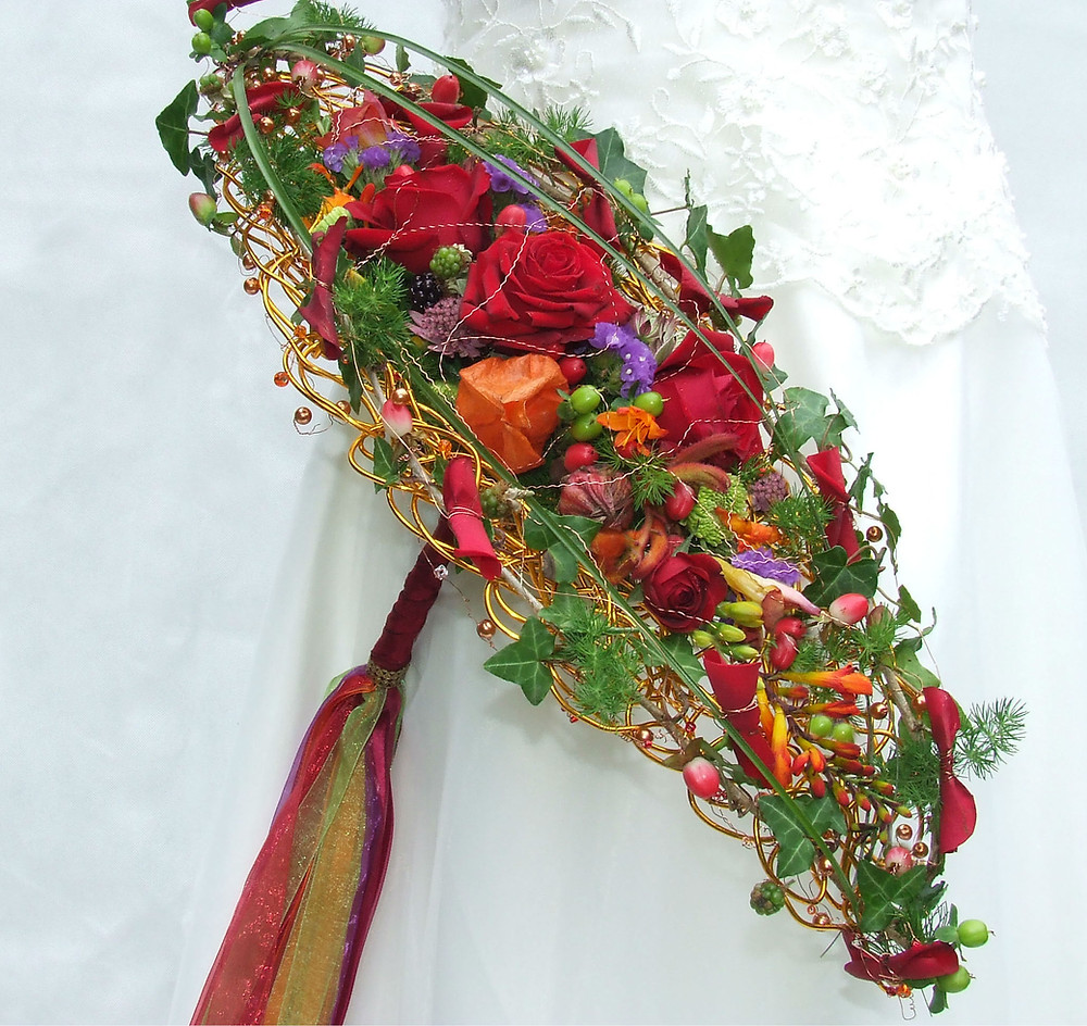 Ellipse bouquet with red roses and greenery