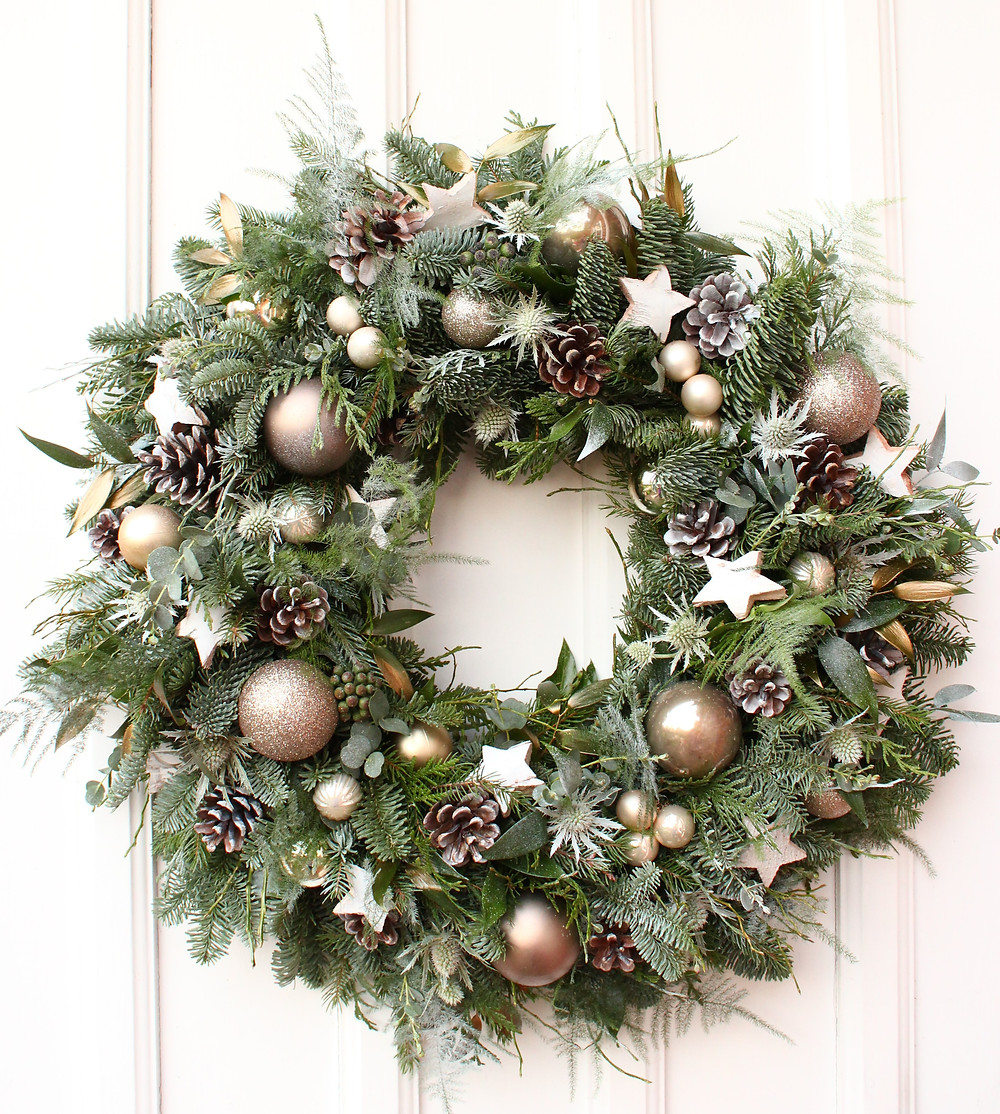 fresh christmas wreath with champagne coloured baubles