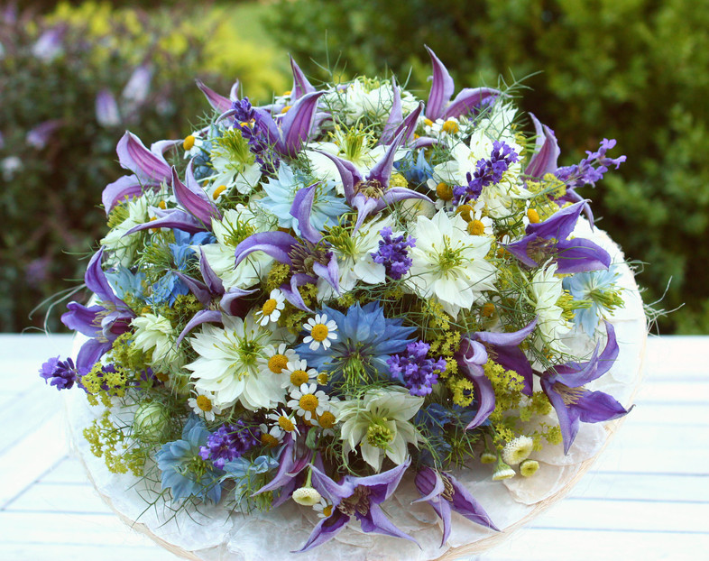 Bridal bouquet with nigella and clematis, in soft shades of blue and purple