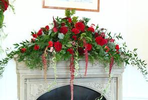 Burgundy mantelpiece arrangement