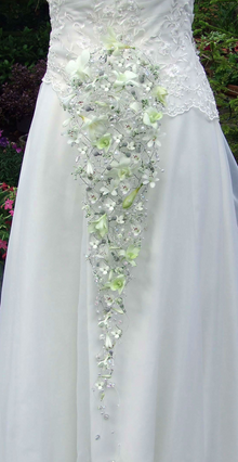 Contemporary cascade bouquet with white orchids