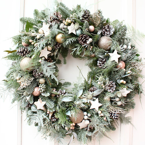 snow white christmas wreath with cones and stars