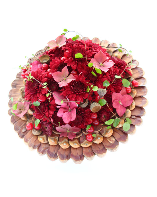 Rich burgundy bouquet with a pine cone collar