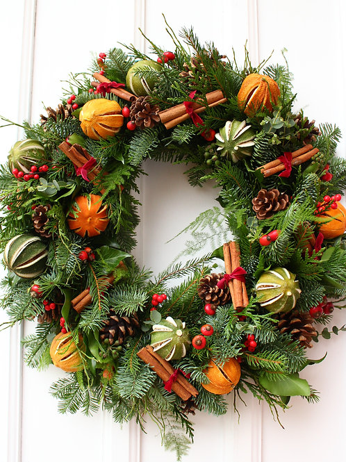 traditional christmas wreath with dried oranges