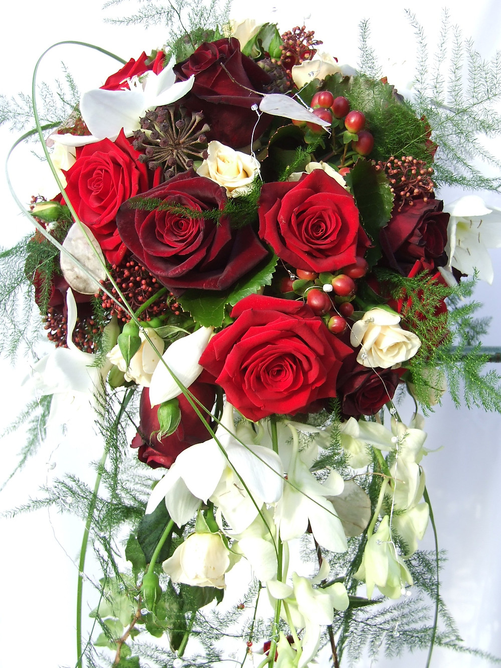 Cascade bouquet in white and reds