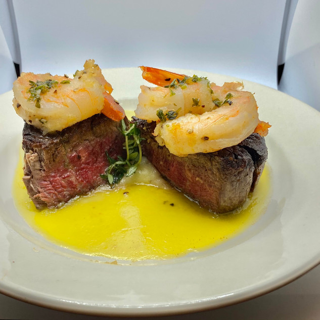 Filet mignon and grilled shrimp in a gar