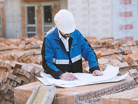 Architect Checking Plans