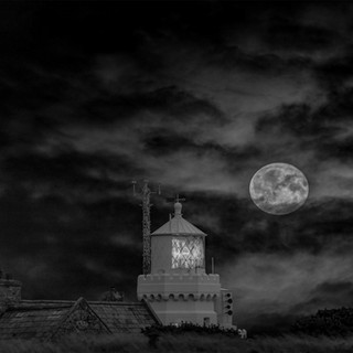full moon over st catherines lighthouse.