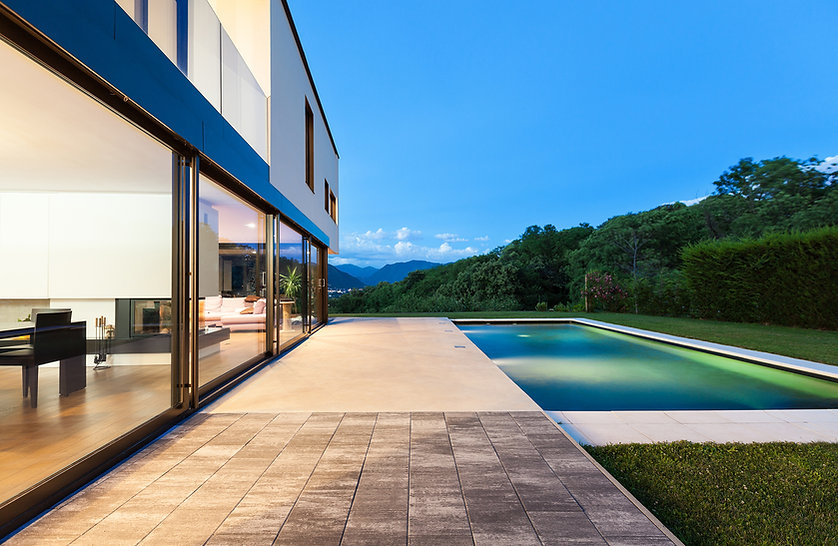 Phuket pool villa with premium quality sliding doors, cotta tile, teak floors, sand stone edging with LED lighting and a beautifule view of Phang Nga.