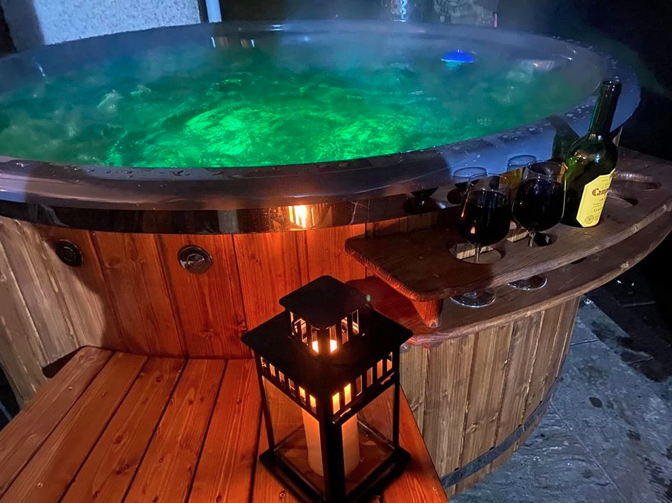 hot tub at night with coloured lights and bubbling water