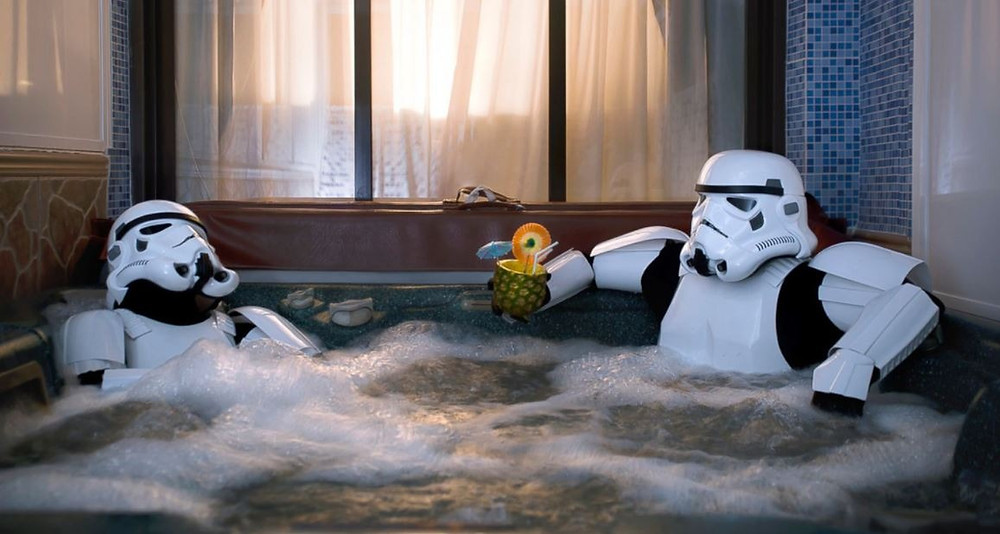 Two Star Wars stormtroopers relaxing in a hot tub