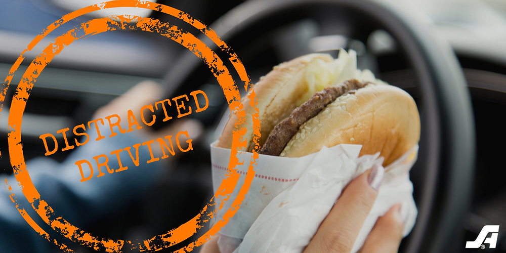 Eating is a common way to be distracted while driving.