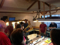 Guys Building Guitars club meeting in the shop.