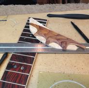 Bridge and fretboard