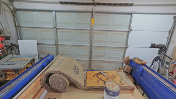 Insulating the garage door for year round comfort. The shop now has year round heat and A/C.
