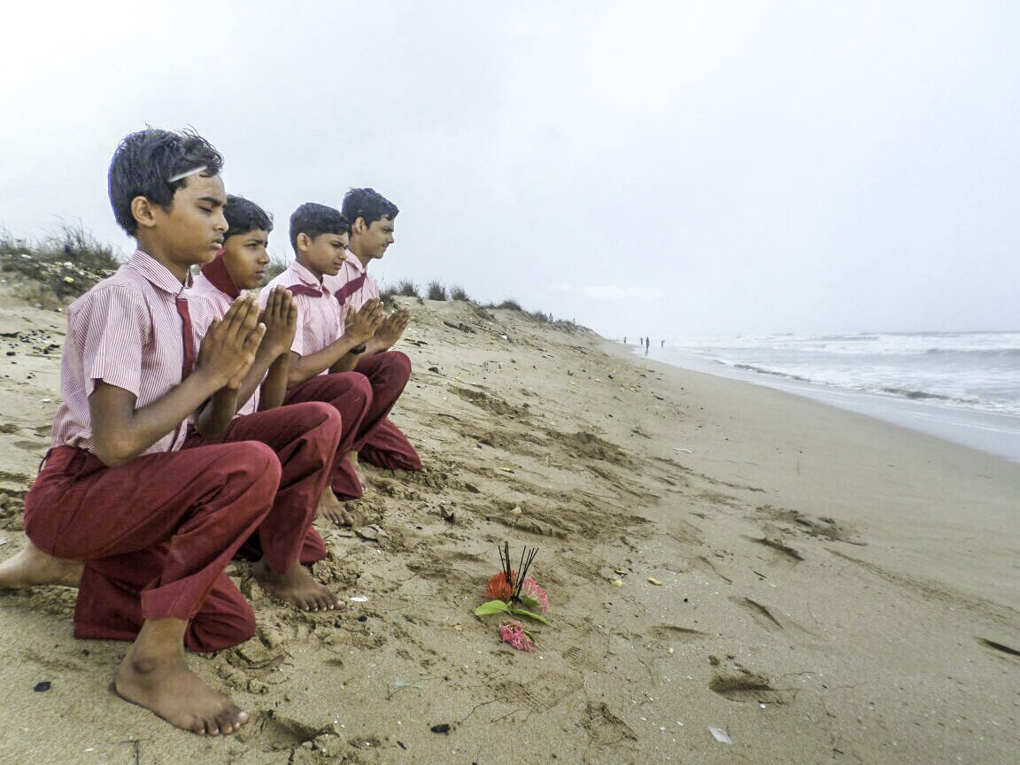 Students respecting the oceans in Gujarat